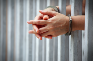 jail_bars_hands