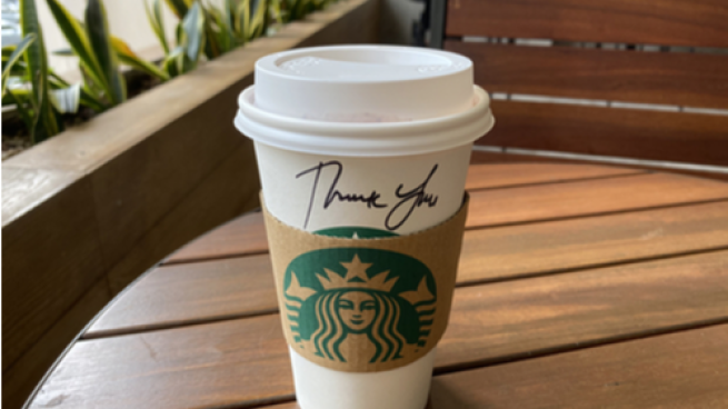Starbucks cup with Thank You written on it