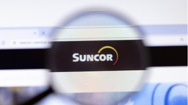 Suncor logo in a magnifying glass