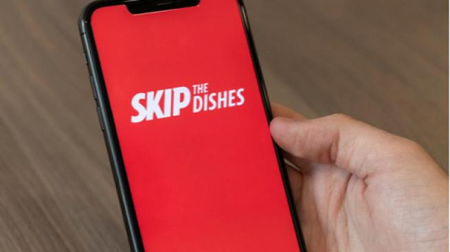skip the dishes logo on cell phone