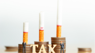 illustration with coins, cigarettes and the word tax