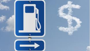 gas station sign with dollar sign in clouds
